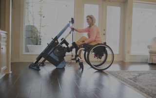 Woman in wheelchair using a FES bike for exercise